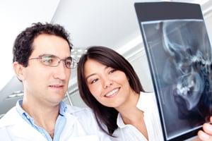 Dentists looking at a cranial x-ray at the hospital