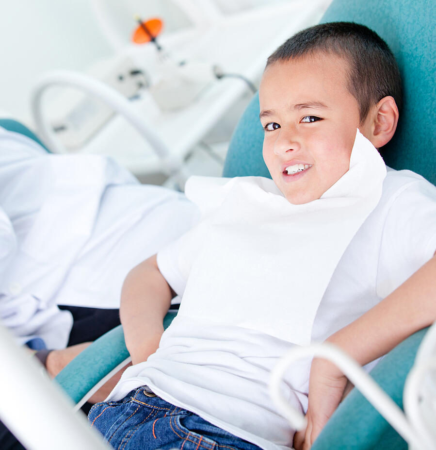 Happy kid visiting the dentist and taking good care of his teeth-1