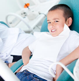 Happy kid visiting the dentist and taking good care of his teeth-2
