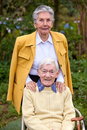 Portrait of an elderly couple smiling outdoors