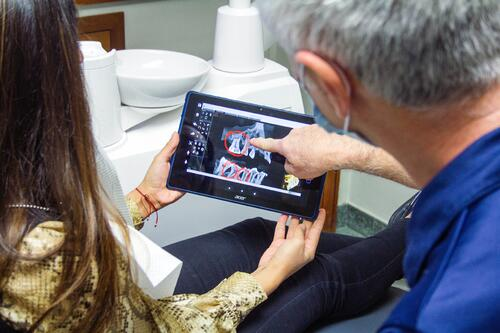Northwest Oral Surgery Understanding Tooth Extraction Oral Surgeon Looking at X-Ray